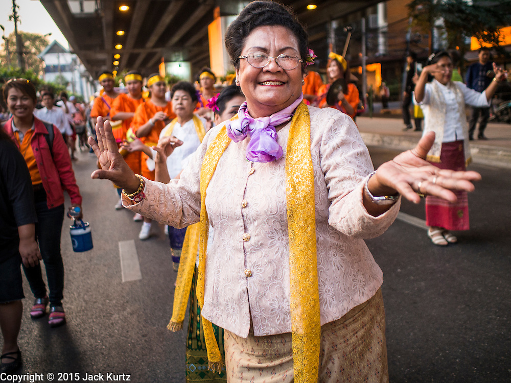 "14 JANUARY 2015 - BANGKOK, THAILAND: Women march in the 2015 Discover Thainess parade. The Tourism Authority of Thailand (TAT) sponsored the opening ceremony of the ""2015 Discover Thainess"" Campaign with a 3.5-kilometre parade through central Bangkok. The parade featured cultural shows from several parts of Thailand. Part of the ""2015 Discover Thainess"" campaign is a showcase of Thailand's culture and natural heritage and is divided into five categories that match the major regions of Thailand – Central Region, North, Northeast, East and South.     PHOTO BY JACK KURTZ"
