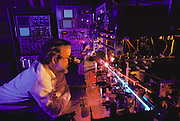 Los Alamos National Lab, New Mexico. Research in the flow cytometry lab - sorting chromosomes for DNA Library. The counting of cells is called cytometry. Flow cytometry characterizes single cells as they pass at high speed through a laser beam. Speeds of up to 50,000 cells a second can be measured. The scattering of the laser beam provides a way to identify the cells. Many other characteristics, such as shape and surface texture can also be measured. The cells are then sorted as electrically charged droplets. This also purifies the samples. (1989).Human Genome Project.