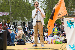 London, UK. 23rd April 2019. Rupert Read, Chair of the Green House thinktank, addresses climate change activists from Extinction Rebellion at an assembly in Parliament Square prior to an attempt to deliver to Parliament activists' letters requesting meetings to discuss climate change with their Members of Parliament.