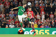 Martín Montoya battles in the air with Southampton striker Shane Long (7) during the Premier League match between Southampton and Brighton and Hove Albion at the St Mary's Stadium, Southampton, England on 17 September 2018.