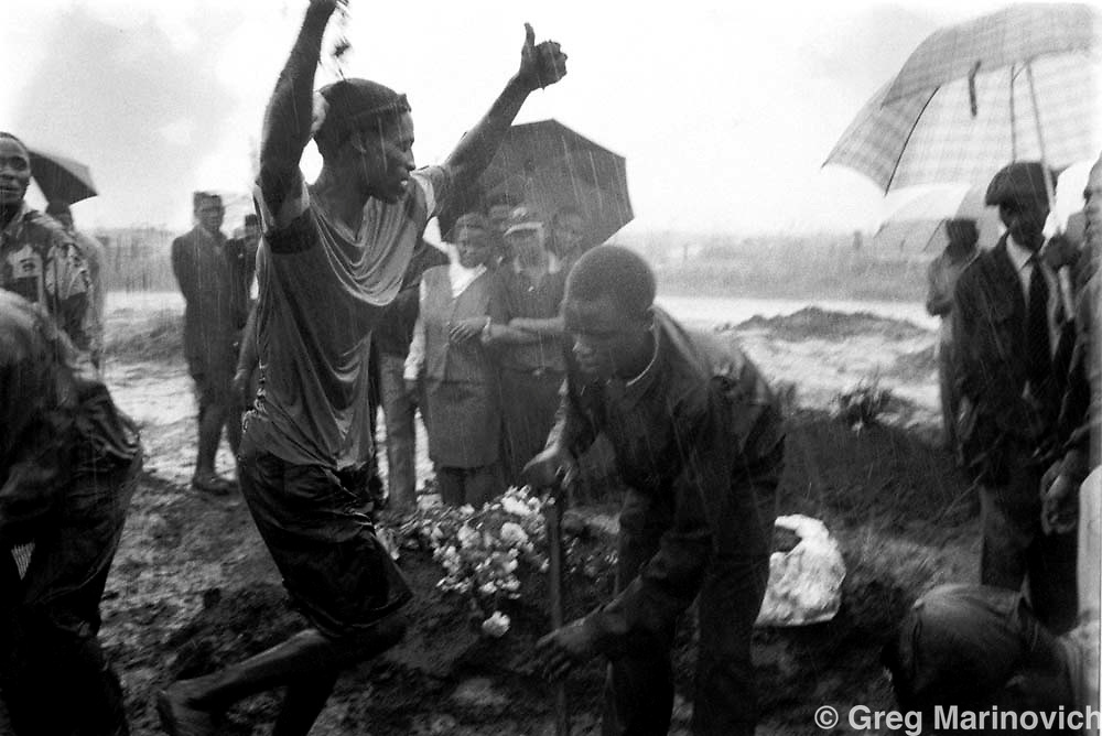 CRIME FUNERAL 16 OCT 1995 - Gangmembers celebrate at the funeral of slain gangster Darkie in Soweto's Avalon cemetary. It is customary to have a party and celebrate rather than mourn at gangsters and criminals funerals. (Photo Greg Marinovich /Getty Images)