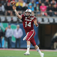 South Carolina Gamecocks quarterback Connor Shaw (14) passes the football during the NCAA Capital One Bowl football game between the South Carolina Gamecocks who represent the SEC and the Wisconsin Badgers who represent the Big 10 Conference, at the Florida Citrus Bowl on Wednesday, January 1, 2014 in Orlando, Florida. (AP Photo/Alex Menendez)