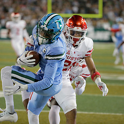 Sep 19, 2019; New Orleans, LA, USA; Tulane Green Wave wide receiver Jalen McCleskey (1) catches a touchdown over Houston Cougars safety Gleson Sprewell (21) and safety Gervarrius Owens (32) during the first quarter at Yulman Stadium. Mandatory Credit: Derick E. Hingle-USA TODAY Sports