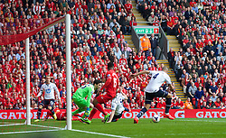LIVERPOOL, ENGLAND - Sunday, March 30, 2014: Tottenham Hotspur's Younes Kaboul scores an own goal during the Premiership match against Liverpool at Anfield. (Pic by David Rawcliffe/Propaganda)