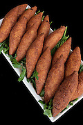 A serving of Kibbeh (Also kubbeh). Kibbeh is meat and spices wrapped in bulgur and deep fried
