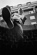 Neville kicking camera, UK, 1980s,