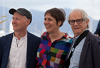 Screenwriter Paul Laverty, Producer Rebecca O'Brien and Director Ken Loach at Sorry We Missed You film photo call at the 72nd Cannes Film Festival, Friday 17th May 2019, Cannes, France. Photo credit: Doreen Kennedy