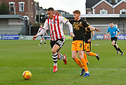 Kane Wilson (20) of Exeter City battles for possession with Brad Halliday (2) of Cambridge United during the EFL Sky Bet League 2 match between Exeter City and Cambridge United at St James' Park, Exeter, England on 26 January 2019.