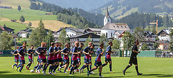 07.07.2015, Steinbergstadion, Leogang, AUT, Trainingslager, RB Leipzig, im Bild die Spieler beim Aufwärmen, dahinter die Kirche von Leogang // during the Trainingscamp of German 2nd Bundesliga Club RB Leipzig at the Steinbergstadium in Leogang, Austria on 2015/07/07. EXPA Pictures © 2015, PhotoCredit: EXPA/ JFK