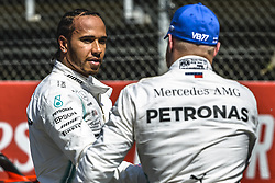 May 11, 2019 - Barcelona, Catalonia, Spain - LEWIS HAMILTON (GBR) from team Mercedes congratulates his team mate VALTTERI BOTTAS (FIN) from team Mercedes to his pole after the qualifying session of the Spanish GP at Circuit de Catalunya (Credit Image: © Matthias Oesterle/ZUMA Wire)