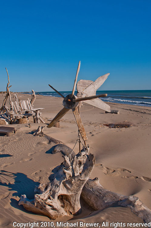 driftwood, creations, sculptures, outsider, art, pirate's village, beach, camargue, sand, sea, shore, ocean, quiet, peaceful, hippies, blue, sky, creativity, travel, tourism, independent, holiday, vacation,