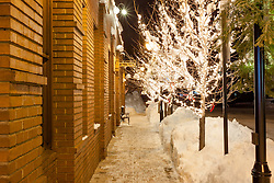 """Walkway in Downtown Truckee 2"" - This icy and snowy walkway was photographed along the Bar of America brick building in Downtown Truckee, California."