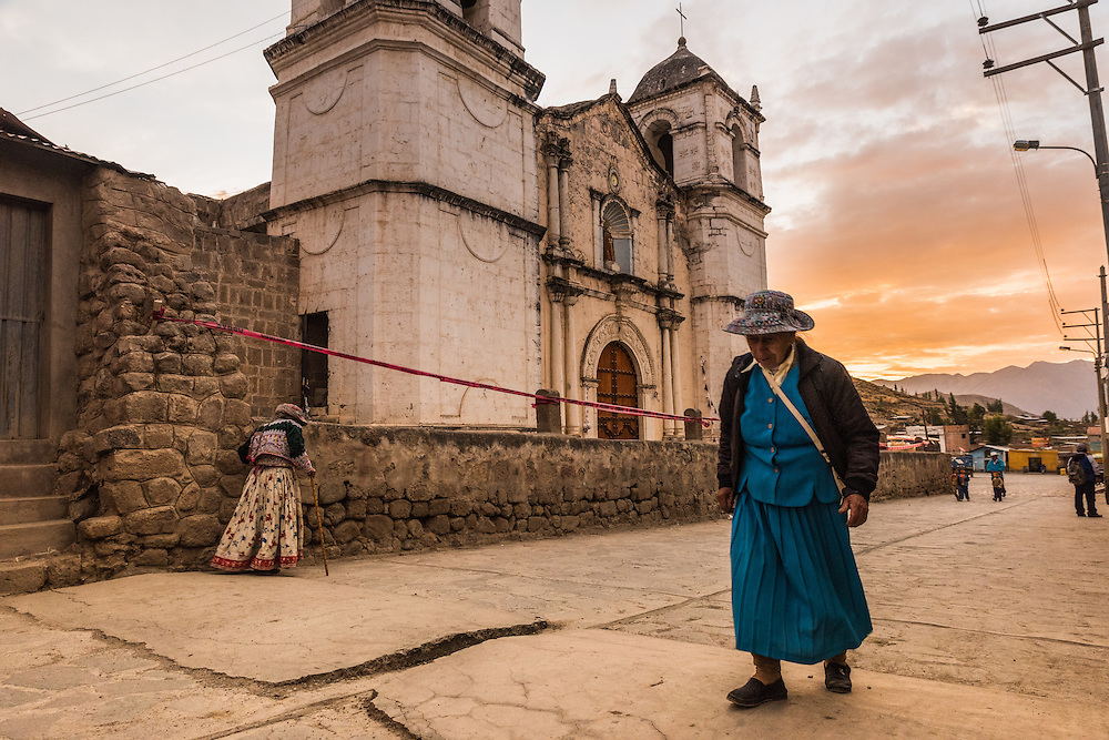 Woman walks in front of the church in the small village of Cabanaconde, Colca Canyon, Peru.