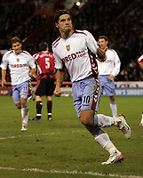 Photo: Paul Thomas.<br /> Sheffield United v Aston Villa. The Barclays Premiership. 11/12/2006.<br /> <br /> Milan Baros (10) celebrates his goal for Villa with Gavin McCann (8).