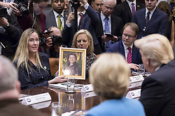 December 18, 2018 - Washington, DC, United States of America - Sandy Hook mother Scarlett Lewis, left, holds up a photo of her son Jesse, killed in the shooting, during a meeting with President Donald Trump on the School Safety report, in the Roosevelt Room of the White House December 18, 2018 in Washington, DC. The 177-page report by the U.S. Education Department contains nearly 100 recommendations, but does not address the key demands for gun control made by school shooting victims and students. (Credit Image: © Joyce N. Boghosian via ZUMA Wire)