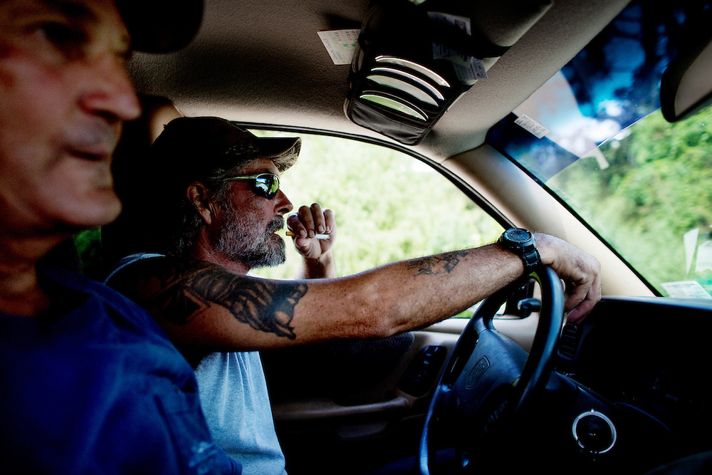 Julius Gaudet, 62, (L) and Rebel drive to get beers after a day of alligator hunting near Shell Island, Louisiana on Saturday, September 19, 2009.