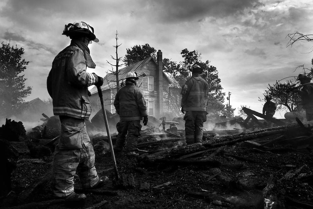 Firefighters work the scene of a barn fire on 800 East Friday afternoon in Muncie, Indiana.