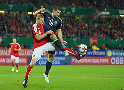 VIENNA, AUSTRIA - Thursday, October 6, 2016: Wales' Sam Vokes in action against Austria's Martin Hinteregger during the 2018 FIFA World Cup Qualifying Group D match at the Ernst-Happel-Stadion. (Pic by David Rawcliffe/Propaganda)