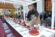 Celebrity Chef Curtis Stone sets the stage for an early Thanksgiving meal inside Ocean Spray's Big Apple Bog, Tuesday, Nov. 3, 2015 at Rockefeller Center in New York.  Chef Stone partnered with the 85-year-old cranberry cooperative to showcase the evolution of the Thanksgiving meal. Find the perfect Thanksgiving plate and holiday inspiration at www.OceanSpray.com/PlanIt.  (Photo by Diane Bondareff/AP Images for Ocean Spray)