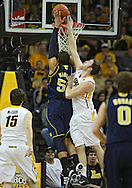 February 19 2011: Michigan Wolverines forward Jordan Morgan (52) is fouled by Iowa Hawkeyes forward Andrew Brommer (20) during the first half of an NCAA college basketball game at Carver-Hawkeye Arena in Iowa City, Iowa on February 19, 2011. Michigan defeated Iowa 75-72 in overtime.