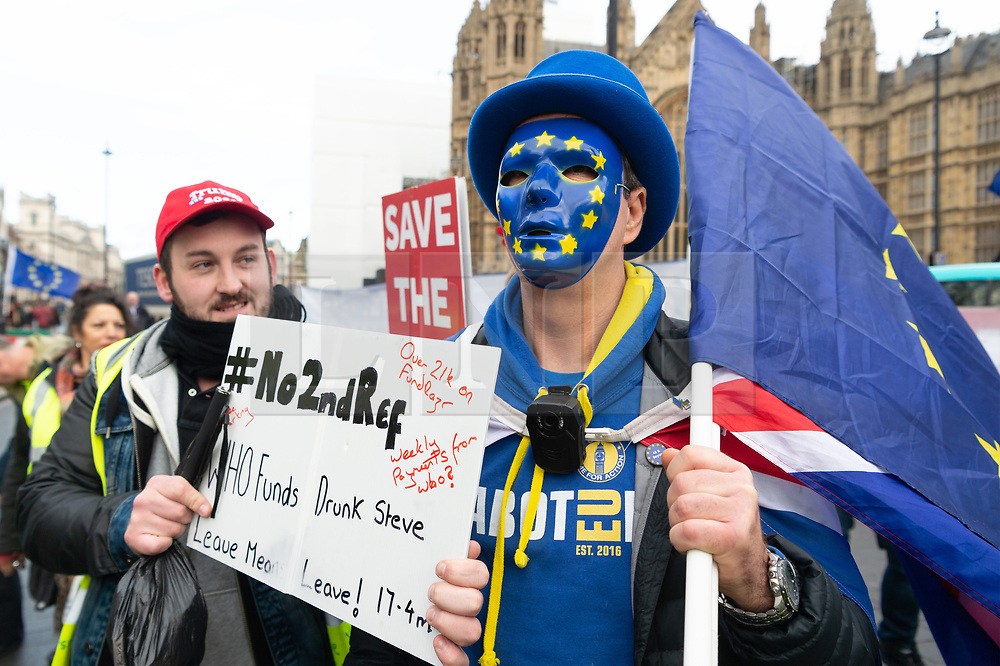 © Licensed to London News Pictures. 19/12/2018. London, UK. Anti-Brexit supporters and pro-Brexit supporters protest outside the Houses of Parliament marking the 100 day countdown to UK Brexit. The British people voted in a referendum to leave the EU and will formally leave by March 29 2019. Photo credit: Ray Tang/LNP