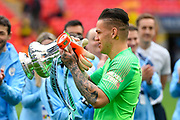 Ederson Moraes (31) of Manchester City walks to the podium on the pitch holding the FA Cup during the The FA Cup Final match between Manchester City and Watford at Wembley Stadium, London, England on 18 May 2019.