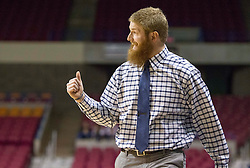 Buckhannon Upshur head coach Jeremy Maxwell yells a play call against Morgantown during a first round game at the Charleston Civic Center.