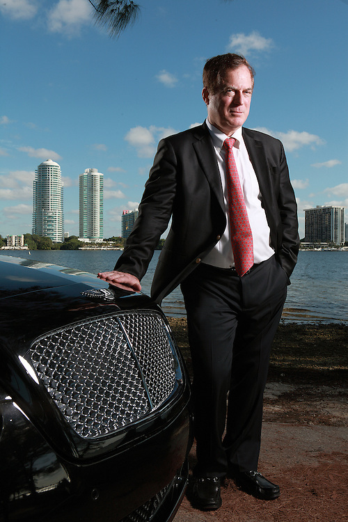 6/12/12-----Miami, Florida-----Photo by Angel Valentin------<br /> Kenneth Rijock stands next to his Bentley convertible in Miami's Key Biscayne neighborhood overlooking Biscayne Bay.