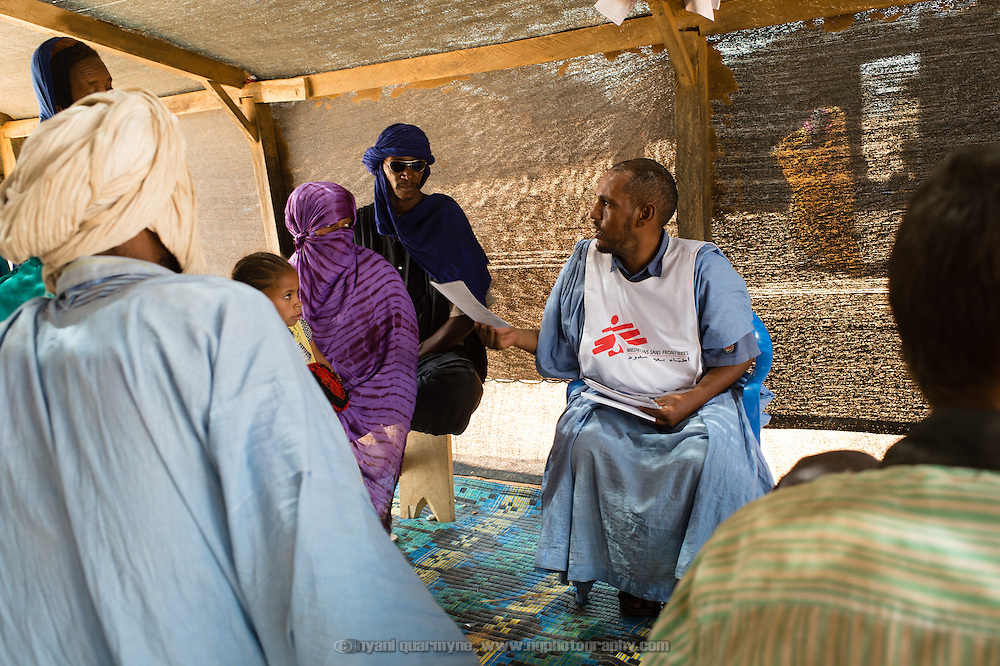 A Médecins Sans Frontières (MSF) orderly managing the queue for consultations at the Médecins Sans Frontières (MSF) health centre at the Mbera camp for Malian refugees in Mauritania on 3 March 2013.