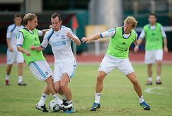 SINGAPORE, SINGAPORE - Sunday, July 17, 2011: Liverpool's Christian Poulsen, new signing Charlie Adam and Dirk Kuyt during an exhibition training session at the Bishan Stadium in Singapore on day seven of the club's preseason Asia Tour. (Photo by David Rawcliffe/Propaganda)