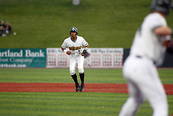 09 June 2011: Frank Martinez gets a large lead off from first base during a game between the Lake Erie Crushers and the Normal Cornbelters at the Corn Crib in Normal Illinois.