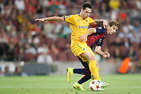 Tomas de Vincenti of Apoel vies with Sergi Samper of Barcelona during the UEFA Champions League, Group F, football match between FC Barcelona and Apoel FC on September 17, 2014 at Camp Nou stadium in Barcelona, Spain. Photo Bagu Blanco / DPPI