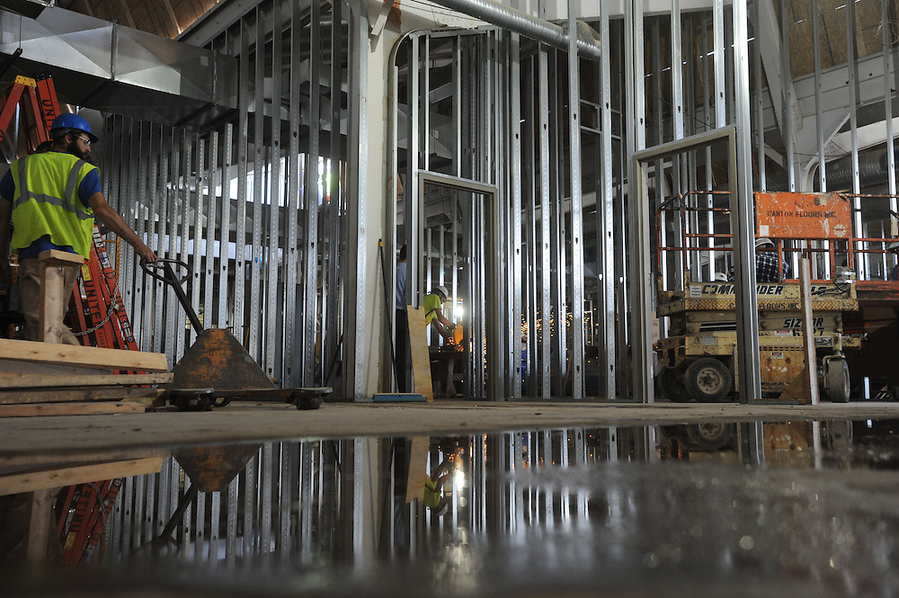 Workers contruct interior walls in the former Van Dusen Hall during the construction of the Center for the Visual Arts. The CVA was made by joining the former power plant and the existing Van Dusen Hall.