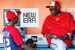 SAN FRANCISCO, CA - JULY 28: Dusty Baker (right) of the Washington Nationals talks to his son Darren Baker (left) in the dugout before the game against the San Francisco Giants at AT&T Park on July 28, 2016 in San Francisco, California. The Washington Nationals defeated the San Francisco Giants 4-2. (Photo by Jason O. Watson/Getty Images) *** Local Caption *** Dusty Baker; Darren Baker