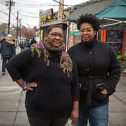 WASHINGTON, DC - NOV 16 :  Kimberly Gaines (R)and Seshat Walker (L), community organizers who are profiling interesting people in their Deanwood neighborhood, stand outside the Riverside Center, November 16, 2013, in Deanwood, Washington, DC. Their project is called My Deanwood, and they photograph community members and write stories about them. (Photo by Evelyn Hockstein/For The Washington Post)