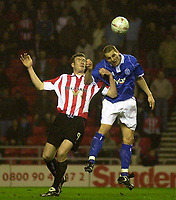 Photo. Glyn Thomas.<br /> Sunderland v Birmingham. FA Cup fifth round.<br /> Stadium of Light, Sunderland. 14/02/2004.<br /> Sunderland's goalscorer Kevin Kyle (L) fights an aerial battle for possession with Darren Purse.