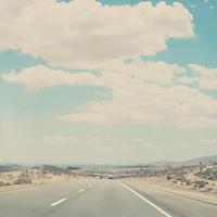 a blurry road running through the Walk Pass in the Sierra Nevadas, California