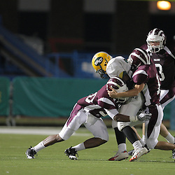 31 October, 2008: St. Thomas Aquinas DB/RB Brandon Robertson (#20), St. Thomas Aquinas LB/WB Charles Robert Miller  (#16) St. Thomas Aquinas WR/CB Ryan Gambel  (#3) The St. Thomas Falcons recorded their first shut out of the season with a 41-0 shutout of the Southern Lab Kittens at Strawberry Stadium in Hammond, LA.