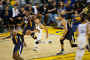 Golden State Warriors guard Stephen Curry (30) dribbles around the Utah Jazz during Game 2 of the Western Conference Semifinals at Oracle Arena in Oakland, Calif., on May 4, 2017. (Stan Olszewski/Special to S.F. Examiner)