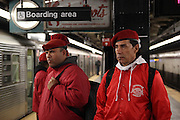 Manhattan, N.Y. October 31, 2013. Guardian Angels E.Q. and Paco wait on the subway platform. 10/31/2013. Photo by Paul McCaffrey/NYCity Photo Wire