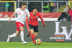 March 27, 2018 - Chorzow, Poland - Maciej Rybus of Poland vies Yong Lee (KOR),   during the international friendly soccer match between Poland and South Korea national football teams, at the Silesian Stadium in Chorzow, Poland on 27 March 2018. (Credit Image: © Foto Olimpik/NurPhoto via ZUMA Press)