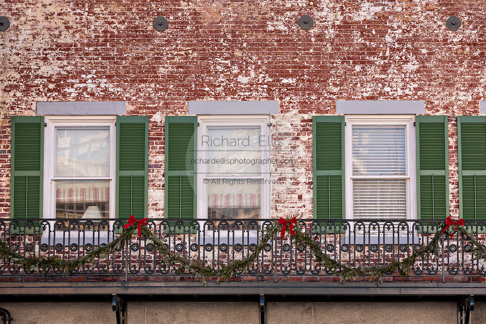 Christmas decorations along the ironwork balcony at The Marshall House Savannah, GA.