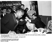 Tom Cruise greeting Cuba Gooding Jr. Group around includes Jim Carreyand Lauren Holly, ( standing)   at the Vanity Fair<br /> Oscar Night Party. Mortons. Los Angeles.  24 March 1997<br /> <br /> © Copyright Photograph by Dafydd Jones<br /> 66 Stockwell Park Rd. London SW9 0DA<br /> Tel 0171 733 0108
