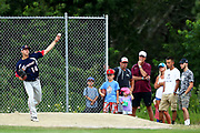 Fans watch Jared Skolnicki of the Bourne Braves warm up in the bullpen during game one of the Cape Cod League Championship Series at Stony Brook Field on August 11, 2017 in Brewster, Massachusetts.