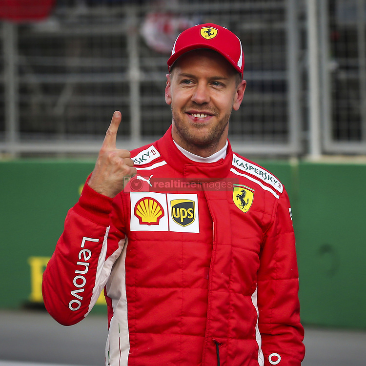 April 28, 2018 - Baku, Azerbaijan - Scuderia Ferrari driver SEBASTIAN VETTEL of Germany celebrates qualifying on pole for the Formula One Azerbaijan Grand Prix. (Credit Image: © Hoch Zwei via ZUMA Wire)