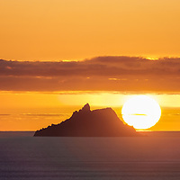 The sun is setting behind Skellig Michael on the Wild Atlantic Way, Co. Kerry, Ireland