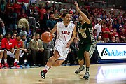 DALLAS, TX - JANUARY 15: Nic Moore #11 of the SMU Mustangs drives to the basket against the South Florida Bulls on January 15, 2014 at Moody Coliseum in Dallas, Texas.  (Photo by Cooper Neill/Getty Images) *** Local Caption *** Nic Moore