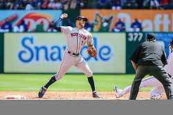 March 29, 2018 - Arlington, TX, U.S. - ARLINGTON, TX - MARCH 29: Houston Astros shortstop Carlos Correa (1) throws the baseball to first base during a double play as Texas Rangers right fielder Nomar Mazara (30) slides into second base during the game between the Texas Rangers and the Houston Astros on March 29, 2018 at Globe Life Park in Arlington, Texas. Houston defeats Texas 4-1. (Photo by Matthew Pearce/Icon Sportswire) (Credit Image: © Matthew Pearce/Icon SMI via ZUMA Press)