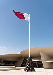 Qatar flag and flagpole at the new National Museum of Qatar in Doha , Qatar. Architect Jean Nouvel.