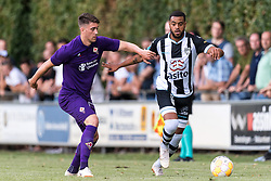 (L-R) David Hancko of ACF Fiorentina, Brandley Kuwas of Heracles Almelo during the Pre-season Friendly match between Heracles Almelo and Fiorentina at Sportpark Wiesel  on August 01, 2018 in Wenum-Wiesel , The Netherlands